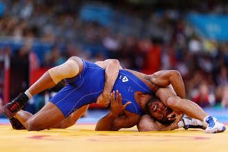 File photo. Yogeshwar Dutt in action against Anatolie Ilarionovitch Gudea of Bulgaria in the Men's Freestyle Wrestling 60kg qualification match of the 2012 Olympic Games in London. Photo: Getty Images