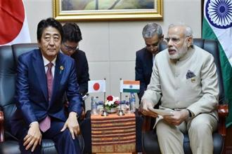 Japan's Prime Minister Shinzo Abe (left) and India's Narendra Modi during a bilateral meeting on the sidelines of the Asean summit in Laos on Wednesday. Photo: PTI
