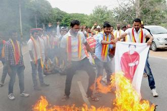 Pro-Kannada activists burn poster of CM J. Jayalalithaa holding a protest in Mysuru on Tuesday in the wake of the Supreme Court directive to Karnataka to release Cauvery water to Tamil Nadu. Photo: PTI