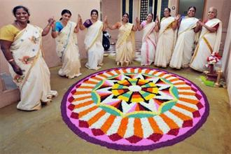 Onam, a 10-day harvest festival, celebrates the symbolic return of king Mahabali to Kerala. Photo: PTI