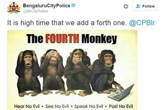 A photograph shared on the Bengaluru City Police's Twitter page depicts not three but four monkeys.
