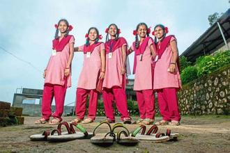 Jagriti Khurkute (second from right) and her classmates sport Greensole's India's slippers. Aniruddha Chowdhury/Mint