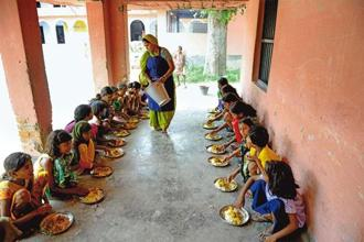 A donation of Rs450 can fund a child's midday meal at school for a whole year. Pradeep Gaur/Mint