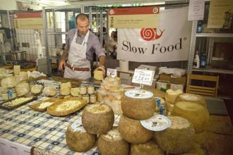 A Slow Food exhibitor showcasing indigenous cheese made by shepherds from the island of Sardinia, Italy. Photo: Ananda Banerjee