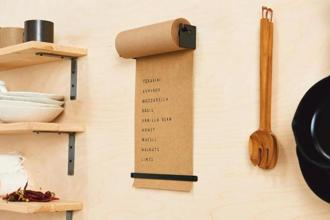 Daily roller lets you jot down lists on brown kraft paper set in a roller made from powder-coated aluminium.
