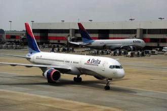 Delta's SkyMiles members can spend 2.5 million miles for a $25,000 jet card. Photo:AFP