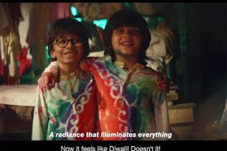 A screen grab from Surf Excel's ad which features a bunch of kids who spoil their clothes with colours to create a rangoli for their washer man at his house.