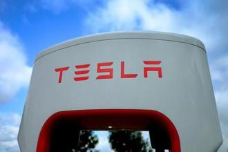 A Tesla electric car charging point is seen at the Eurotunnel terminal in Calais, France. Photo:Reuters