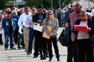 People wait in line to enter The Nassau County mega job fair at Nassau Veterans Memorial Coliseum in Uniondale, New York. Photo: Reuters