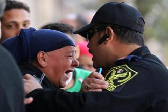 A relative of one of the blast victims screams at a police officer in front of St. Mark's Coptic Orthodox Cathedral after an explosion inside the cathedral in Cairo. Photo: Reuters