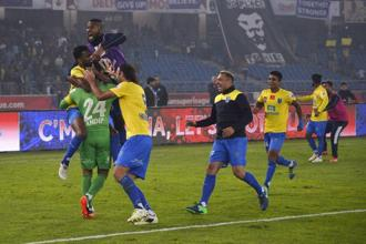 Kerala Blasters FC players celebrates after winning the second leg of the semi-final football match against Delhi Dynamos FC at Jawahar Lal Nehru Stadium in New Delhi. Photo: AFP