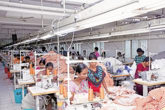 Workers at a garment factory in Tirupur, Tamil Nadu. Some garment units have stopped taking fresh orders as they struggle to finish pending ones. Photo: JK Rathankumar/Mint