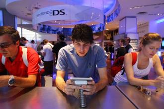 Nintendo has been criticized for the cost of the game, which is free to download and play the first three levels but costs $10 for the full version. Photo: Bloomberg
