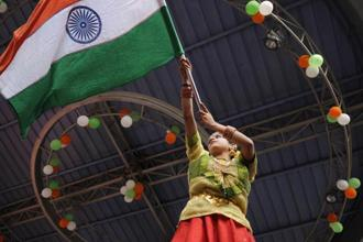 File photo: A girl holding a national flag during an event organised during India's Republic Day celebrations, in Noida. Photo: Burhaan Kinu/Hindustan Times