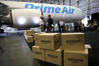 Amazon is building its own fleet of planes to handle the rise in orders. Photo: AP
