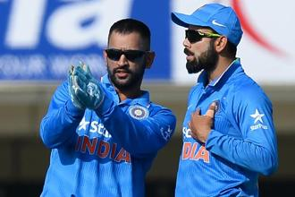 Virat Kohli took to social media to join the outpouring of tributes to M.S. Dhoni's captaincy. Photo: AFP