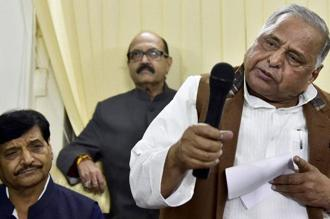 SP supremo Mulayam Singh Yadav (right) with party leaders Amar Singh (centre) and Shivpal Yadav during a press conference at his residence in New Delhi on Sunday. Photo: PTI