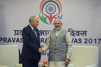 French foreign minister Jean-Marc Ayrault (Left) shake hands with Prime Minister Narendra Modi at the Pravasi Bharatiya Divas event in Bangalore on 8 January 2017. Photo: AFP
