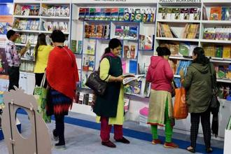 Readers explore books of various categories at the World Book Fair in Pragati Maidan, New Delhi. Photo: PTI