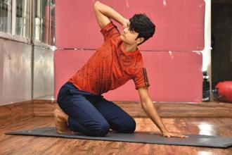 This movement extends all the vertebrae in the thoracic spine and encourages mobility in that area. Photos: Indranil Bhoumik/Mint