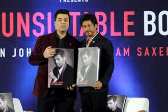 Karan Johar (left) and actor Shah Rukh Khan pose during a promotional event for his autobiography 'An Unsuitable Boy', in Mumbai on Monday. Photo: AFP