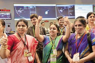 There has never been a woman head at the Isro—even though the iconic image of women scientists celebrating the launch of India's Mars mission is often used to symbolize the great surge forward by women in science. Photo: AFP