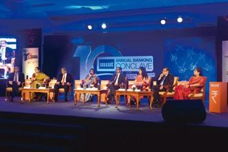 (From left) Citibank India CEO Pramit Jhaveri, Axis Bank MD and CEO Shikha Sharma, HDFC Bank MD Aditya Puri, SBI chairman Arundhati Bhattacharya, Mint's consulting editor Tamal Bandyopadhyay, ICICI MD and CEO Chanda Kochhar, Bank of Baroda MD and CEO P.S. Jayakumar, and Punjab National Bank MD and CEO Usha Ananthasubramanian at the 10th Mint Annual Banking conclave in Mumbai. Photo: Abhijit Bhatlekar/Mint
