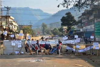 Bandh supporters block a road during a strike call given by the joint coordination committee against 33% women's reservation and killing of two person in police firing in Dimapur, Nagaland, on Friday. Photo: PTI