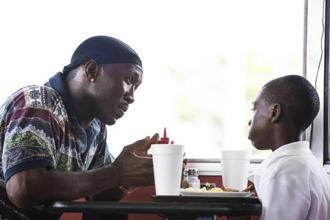 Mahershala Ali and Alex Hibbert in a scene from 'Moonlight'. Photo: AP