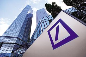 Though Deutsche Bank told staff last month that it was scaling back bonuses, the full magnitude of the cuts hadn't been reported. Photo: Bloomberg