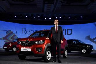 Carlos Ghosn with the Renault Kwid. Ghosn is stepping down as Nissan CEO to focus on Renault-Nissan alliance's Mitsubishi acquisition. Photo: Sai Sen/Mint