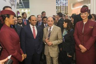 Qatar Airways CEO Akbar Al Baker (right) said on Wednesday that the company will start an airline in India, the world's fastest-growing aviation market, together with Qatar's sovereign fund. Photo:  Rolf Schulten/Bloomberg