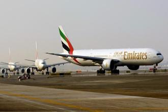 Emirates has established itself as the world's biggest carrier serving international routes by transforming Dubai into a transfer hub for flights between the Americas and Europe and the Asia-Pacific, Middle East and Africa. Photo: Bloomberg