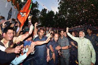 Narendra Modi led the BJP's election victory march in New Delhi on Sunday. Photo: PTI