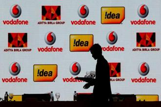 Vodafone's investors have been recommending an exit from India, but the company has chosen the middle path by going for a merger with Idea Cellular and retaining a small stake in the combined entity. Photo: Reuters