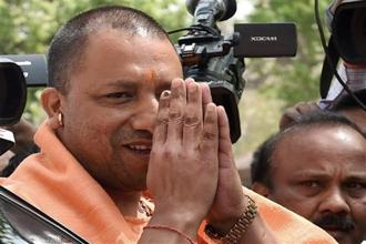 Yogi Adityanath promised to make UP riot-free, corruption-free and safe for women and said he will establish a development model which will discourage emigration. Photo: PTI