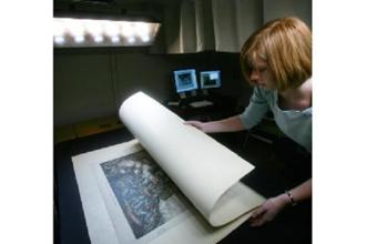 A file photograph of a digital imaging technician at the US Library of Congress. Photo: AFP