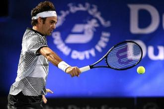 Roger Federer plays a backhand during a match in Dubai in February. Photo: Dulat/Getty Images