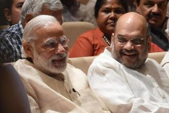 BJP president Amit Shah speaks with Prime Minister Narendra Modi during a BJP parliamentary meet in New Delhi. Photo: AFP