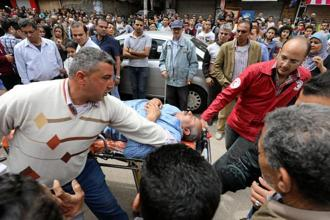 A victim is seen on a stretcher after a bomb went off at a Coptic church in Tanta, Egypt, on Sunday. Photo: Reuters