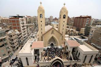 Egyptians gather by a Coptic church that was bombed on Sunday in Tanta, Egypt, on Sunday. Photo: Reuters