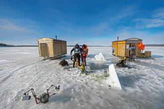 A view of the expansive ice cover on the White Sea, which remains intact from mid-January to April. Cabins with equipment need to be brought out to the sea on snowmobiles and holes made through ice to dive. Photographs by Dhritiman Mukherjee