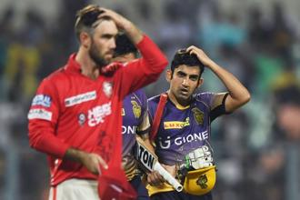 Kolkata Knight Riders captain Gautam Gambhir (R) and Kings XI Punjab cricketer Glenn Maxwell gesture after the 2017 Indian Premier League (IPL) Twenty20 cricket match between Kolkata Knight Riders and Kings XI Punjab at The Eden Gardens Cricket Stadium in Kolkata on Thursday. The result proved that KKR are a tough side to beat at home and with today's win, they completed an 11th successful chase on this ground. Photo: AFP