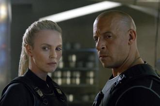 A still featuring actors Charlize Theron (left) and Vin Diesel. The international debut for 'The Fate of the Furious' was four times bigger than its North American opening of an estimated $100 million. Photo: AP