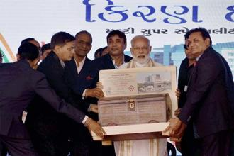 PM Narendra Modi during the dedication ceremony of Kiran Multispeciality Hospital in Surat on Monday. Photo: PTI