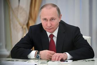 Russian President Vladimir Putin controls the Russian Institute for Strategic Studies, the think tank that developed a plan to sway the 2016 US elections in favour of Donald Trump and against Hillary Clinton. Photo: AP