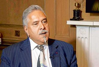 The London court ordered Vijay Mallya not to leave England or Wales and keep his mobile phone—fully charged—with him at all times. Photo: PTI