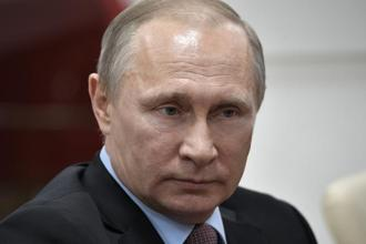 Vladimir Putin has denied interfering in the US election. Photo: AP
