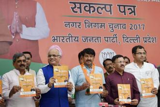 Delhi President Manoj Tiwari, centre, along with other leaders releasing BJP Sankalp Patr manifesto for MCD elections 2017 in New Delhi. Photo: PTI