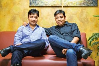 CarDekho founders Amit Jain (left) and Anurag Jain.